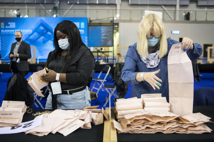 Votes are counted for the Scottish Parliamentary Elections at the Emirates Arena,in Glasgow, Scotland, Saturday May 8, 2021. (Jane Barlow/PA via AP)