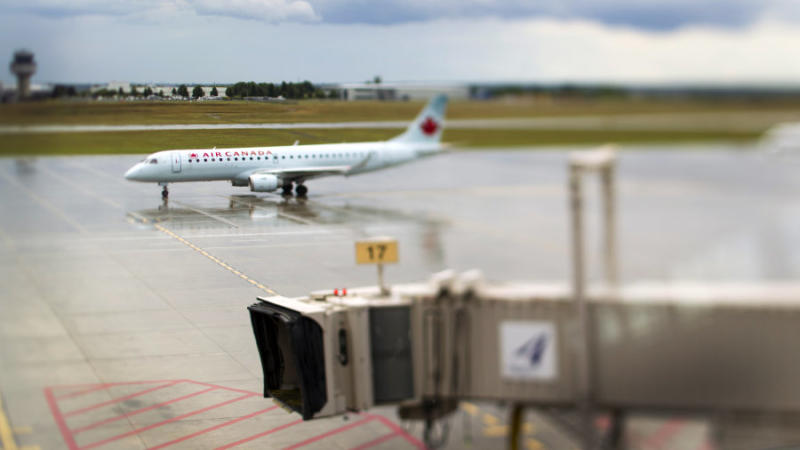 An Air Canada airplane taxis down the tarmac at Ottawa International Airport on Aug. 10, 2011.