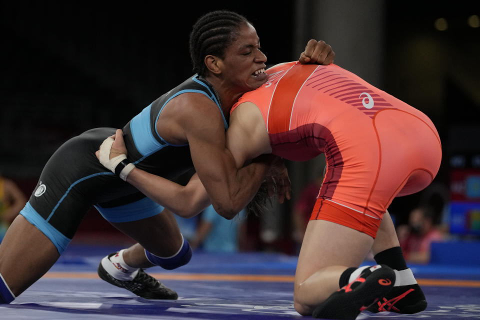 Guinea's Fatoumata Yarie Camara, left, and Japan's Risako Kawai compete during the women's 57kg freestyle wrestling match at the 2020 Summer Olympics, Wednesday, Aug. 4, 2021 in Chiba, Japan. Camara is the only Guinean athlete to qualify for these Games. (AP Photo/Aaron Favila)