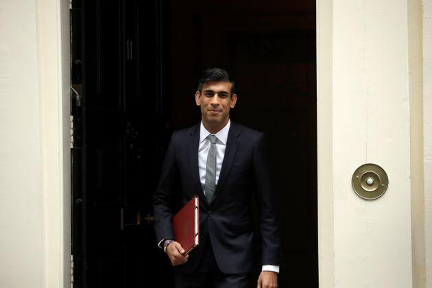 Chancellor of the Exchequer Rishi Sunak leaves number 11 Downing Street, to deliver a financial announcement to the Houses of Parliament