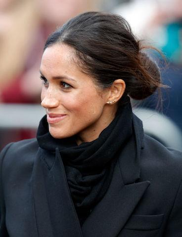 <p>For her first trip to Cardiff, Meghan graced the headlines once more thanks to her royal protocol-breaking bun. But this time, she slicked back any stray wisps of hair for a more polished look. (Photo: Getty Images) </p>