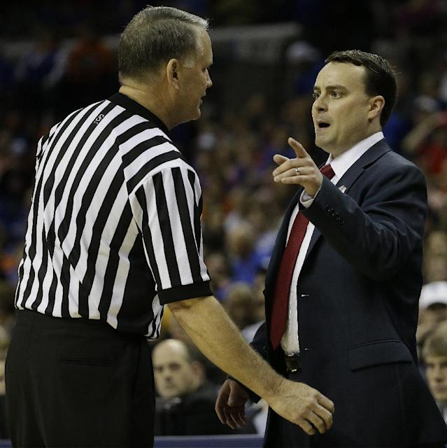 Dayton head coach Archie Miller speaks to an official during the first half in a regional final game against Florida at the NCAA college basketball tournament, Saturday, March 29, 2014, in Memphis, Tenn. (AP Photo/Mark Humphrey)