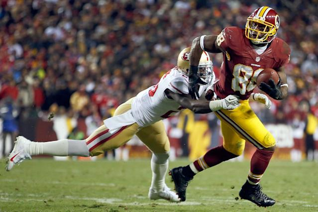 Washington Redskins wide receiver Pierre Garcon is tackled by San Francisco 49ers defensive back Tramaine Brock during the first half of an NFL football game in Landover, Md., Monday, Nov. 25, 2013. (AP Photo/Evan Vucci)