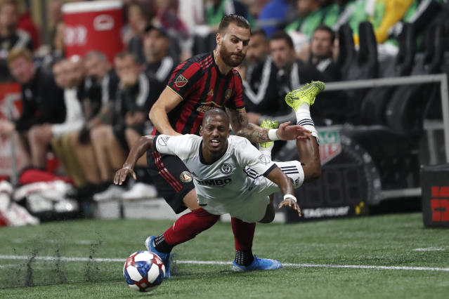 Atlanta United defender Leandro Gonzalez, rear, battles Philadelphia Union forward Fafa Picault (9) for control the ball during the first half of an MLS soccer Eastern Conference semifinal Thursday, Oct. 24, 2019, in Atlanta. (AP Photo/John Bazemore)