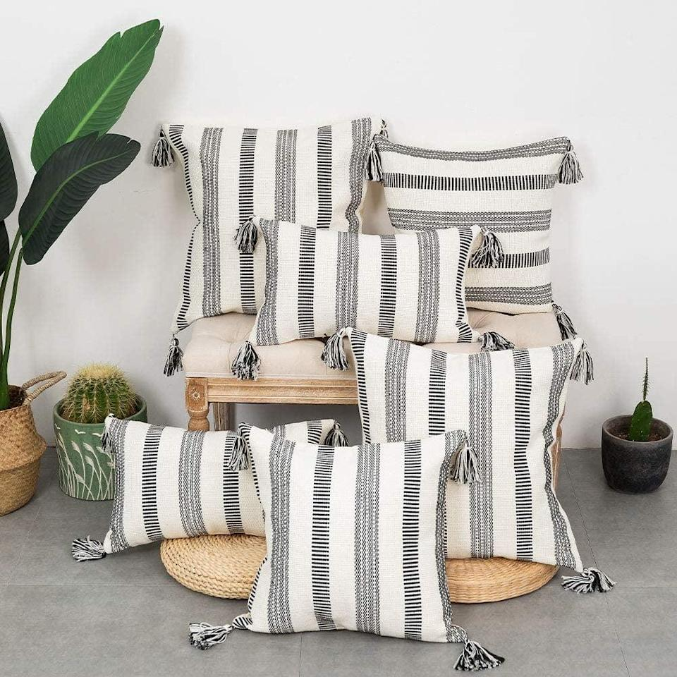 <p>A few of these <span>blue page Set of 2 Cotton Black and White Stripe Neutral Throw Pillow Cases</span> ($27-$31) will add an elevated touch to your furniture.</p>