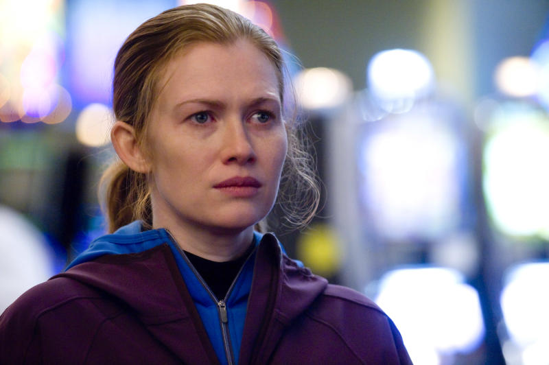 """In this publicity image released by AMC, Mireille Enos is shown in a scene from """"The Killing.""""  Enos plays Seattle Homicide Detective Sarah Linden, who, through the AMC drama's 13-episode season, is investigating a grisly case: the drowning murder of a local teenager named Rosie Larsen. (AP Photo/AMC, Carole Segal)"""