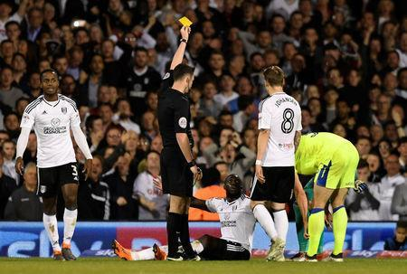 Soccer Football - Championship Play Off Semi Final Second Leg - Fulham vs Derby County - Craven Cottage, London, Britain - May 14, 2018 Fulham's Aboubakar Kamara is shown a yellow card by referee Chris Kavanagh Action Images via Reuters/Tony O'Brien