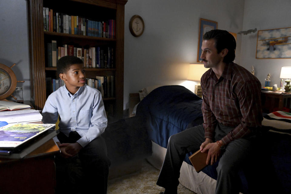 "This image released by NBC shows Lonnie Chavis as Randall, left, and Milo Ventimiglia as Jack, in a scene from ""This Is Us,"" airing on Tuesday at 9 p.m. EST. (Mitchell Haddad/NBC via AP)"