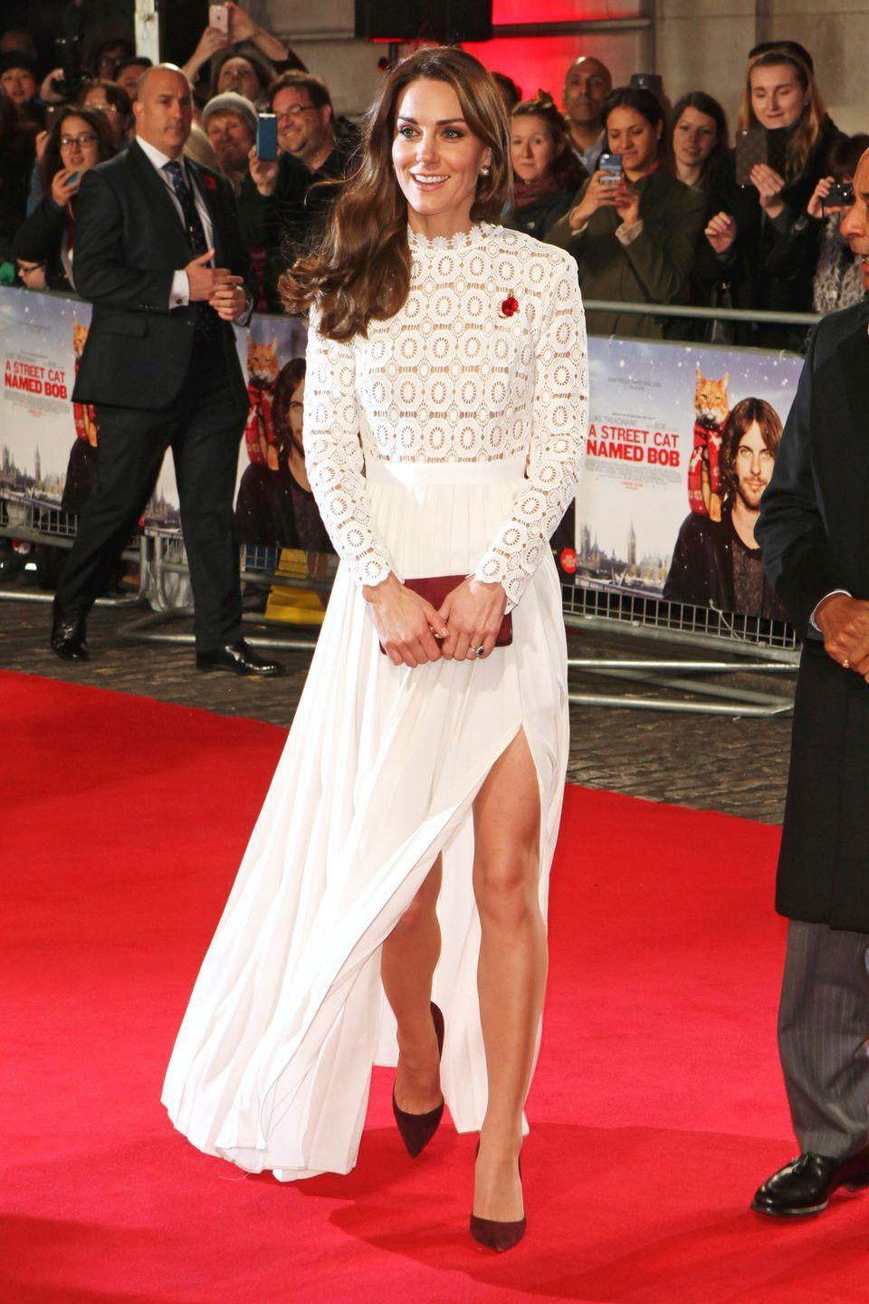 <p>In a white lace dress with a thigh-high slit by Self Portrait, suede oxblood pumps and a matching clutch at the premiere of <em>A Street Cat Named Bob</em> in London.</p>
