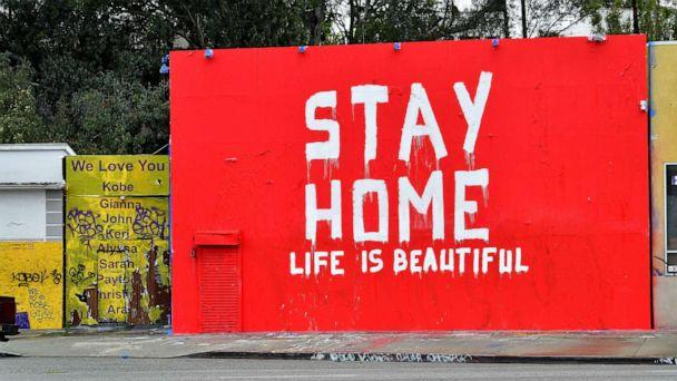 PHOTO: A mural seen in Los Angeles, California, on April 6, 2020 delivers a simple message, 'Stay home, life is beautiful.' (Frederic J. Brown/AFP via Getty Images)
