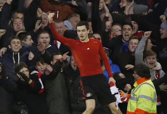 Sunderland's Adam Johnson celebrates his second goal against Fulham during their English Premier League soccer match at Craven Cottage, London, Saturday, Jan. 11, 2014. (AP Photo/Sang Tan)