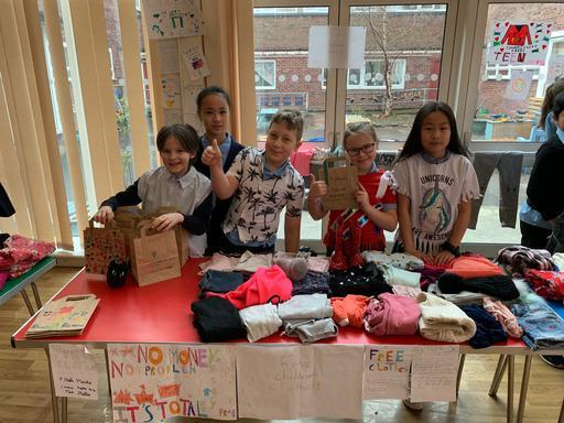 Children from St Joseph's Primary School in Glasgow set up a clothes stall (Social Enterprise Academy/The Big Issue/PA)