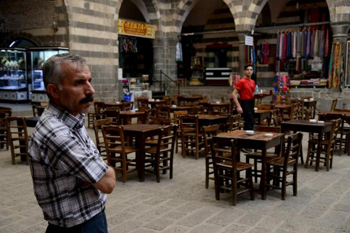 An empty cafe awaits customers on October 1, 2015, at the once-bustling Hasan Pasa caravansary in the southeastern Turkish city of Diyarbakir, which has seen tourists and shoppers evaporate amid fresh violence in the Kurdish conflict (AFP Photo/Ilyas Akengin)