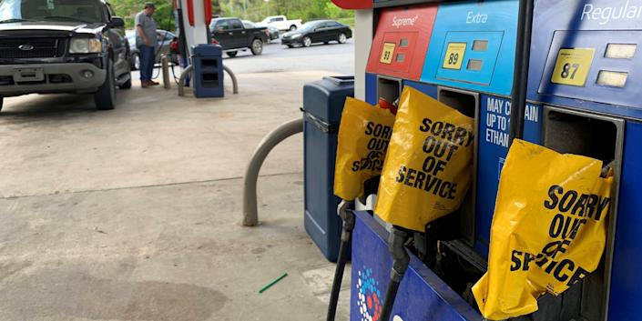 Out of service fuel nozzles are covered in plastic on a gas pump at a gas station in Waynesville, North Carolina, after a gasoline supply crunch caused by the Colonial Pipeline hack