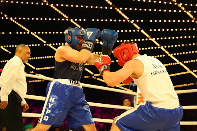 <p>Abe Niedzwoecki (blue) defends against Al Schneider (red) in the Brooklyn Queens Fisticuffs in the NYPD Boxing Championships at the Hulu Theater at Madison Square Garden on March 15, 2018. (Gordon Donovan/Yahoo News) </p>