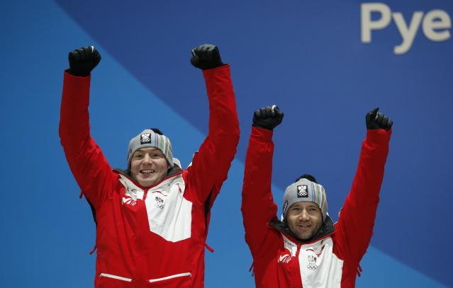 Medals Ceremony - Luge - Pyeongchang 2018 Winter Olympics - Men's Doubles - Medals Plaza - Pyeongchang, South Korea - February 16, 2018 - Silver medalists Peter Penz and Georg Fischler of Austria on the podium. REUTERS/Kim Hong-Ji