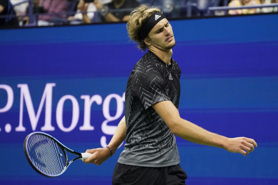 Alexander Zverev, of Germany, reacts after losing a point to Novak Djokovic, of Serbia, during the semifinals of the US Open tennis championships, Friday, Sept. 10, 2021, in New York. (AP Photo/John Minchillo)
