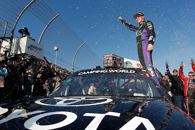 MARTINSVILLE, VA - OCTOBER 29: Denny Hamlin, driver of the #18 Toyota/Traxxas Toyota, celebrates after winning the NASCAR Camping World Truck Series Kroger 200 at Martinsville Speedway on October 29, 2011 in Martinsville, Virginia. (Photo by Geoff Burke/Getty Images for NASCAR)