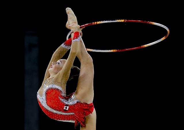 Gold medalist Patricia Bezzoubenko of Canada performs in the Individual Hoop final at the Scottish Exhibition and Conference Centre Precinct during the Commonwealth Games 2014 in Glasgow, Scotland, Saturday July 26, 2014. (AP Photo/Kirsty Wigglesworth)