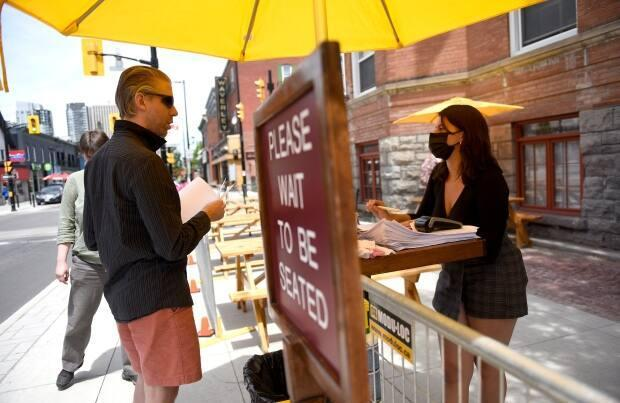 Patios have been much busier since Ontario entered the second phase of its latest reopening plan. (Justin Tang/The Canadian Press - image credit)