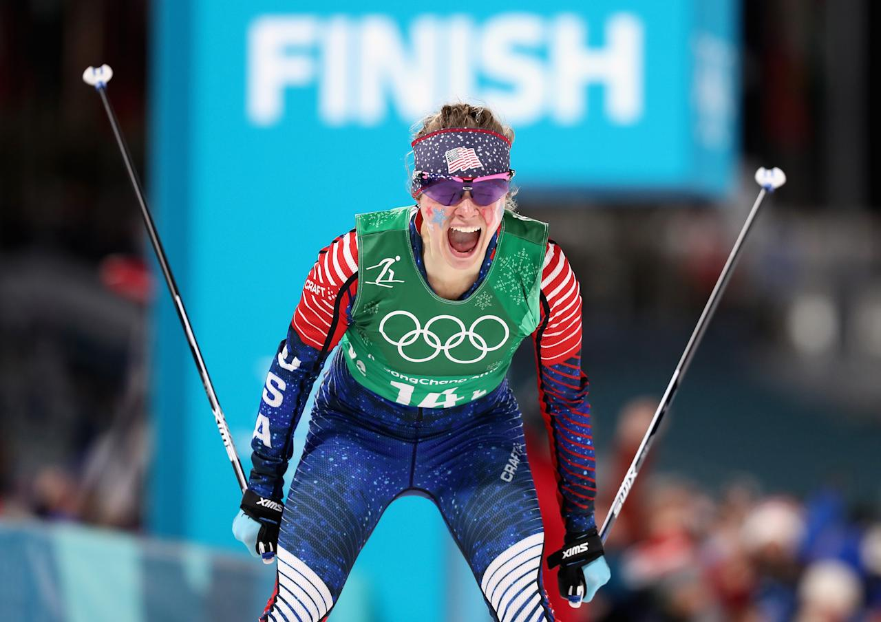 <p>Jessica Diggins of the United States celebrates as she crosses the line to win gold during the Cross Country Ladies' Team Sprint Free Final at the 2018 Winter Olympic Games in Pyeongchang, South Korea on February 21, 2018.<br /> (Photo by Lars Baron/Getty Images) </p>