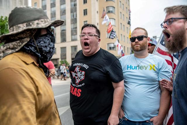 People protest against mandates to wear masks in Austin, Texas (REUTERS)