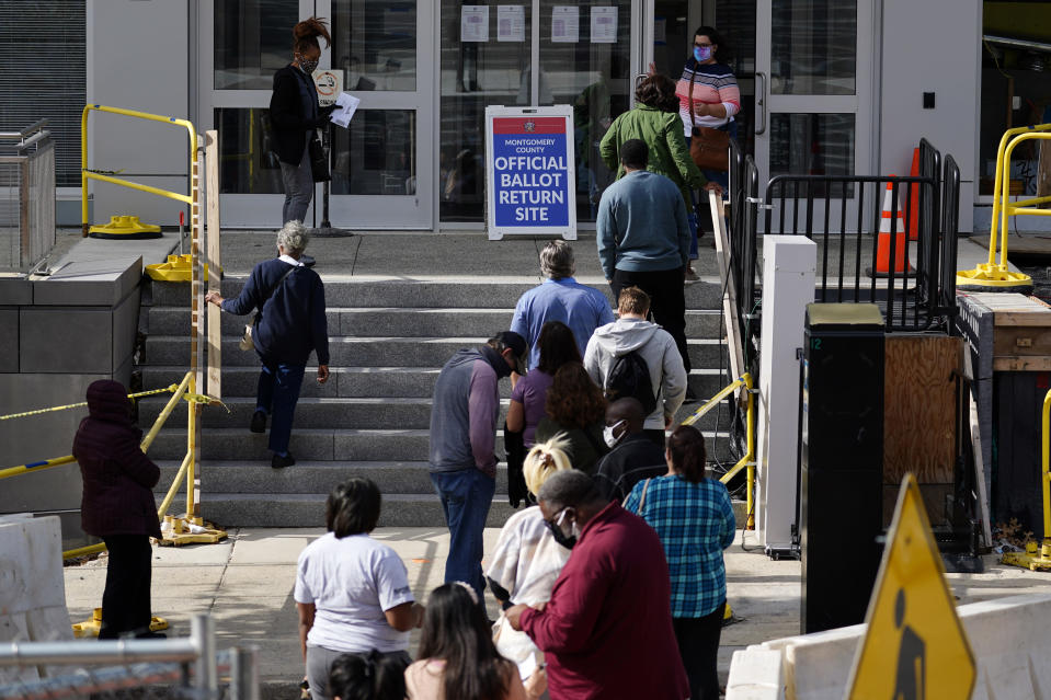 Residents line up outside the Montgomery County, Pa., Voter Services office, Monday, Oct. 19, 2020, in Norristown, Pa. Monday is the last day in Pennsylvania to register to vote in the Nov. 3 election in which the presidential battleground state is playing a central role in the contest between President Donald Trump and former Vice President Joe Biden. (AP Photo/Matt Slocum)