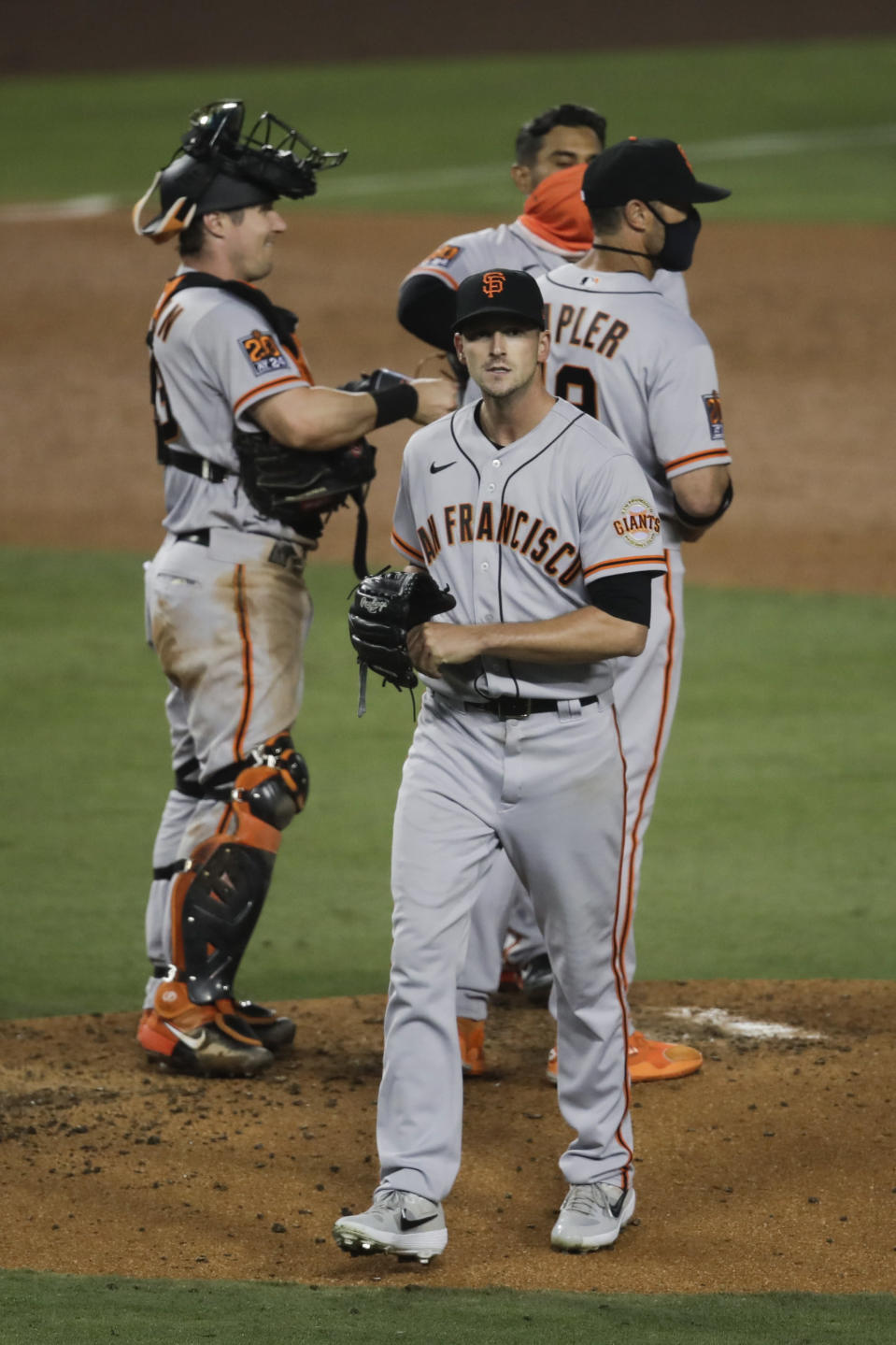 San Francisco Giants starting pitcher Drew Smyly, center, leaves the mound after he was removed by manager Gabe Kapler during the fourth inning of the team's baseball game against the Los Angeles Dodgers, Sunday, July 26, 2020, in Los Angeles. (AP Photo/Jae C. Hong)