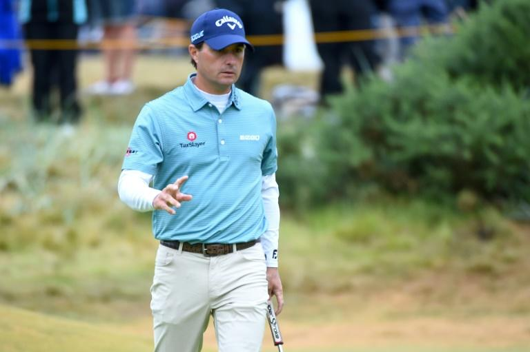 Kevin Kisner reacts to making a birdie putt on the 9th green during his second round