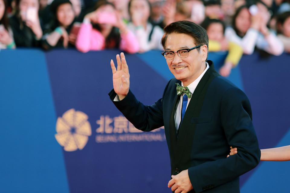 BEIJING, CHINA - APRIL 16:  (CHINA OUT) Actor Ng Man Tat arrives at the red carpet of the 5th Beijing International Film Festival at Yanqi Lake on April 16, 2015 in Beijing, China.  (Photo by Visual China Group via Getty Images)