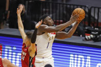New Orleans Pelicans forward Zion Williamson (1) goest the basket past Miami Heat guard Tyler Herro (14) during the second half of an NBA basketball game, Friday, Dec. 25, 2020, in Miami. (AP Photo/Joel Auerbach)