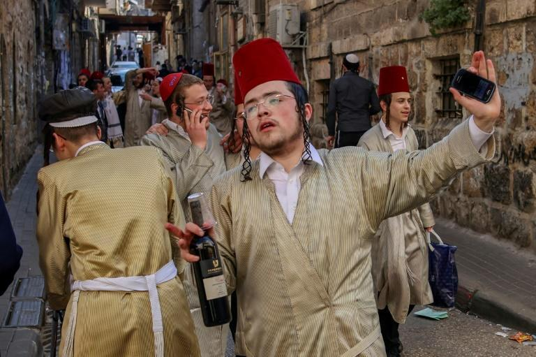Dozens of ultra-Orthodox Jews defied Israel's lockdown to mark the Purim holiday. Some threw stones at police in Jerusalem as tensions persist between authorities and the deeply devout community