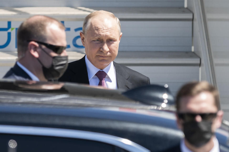 Russian president Vladimir Putin, center gets into his car after his arrival for the US - Russia summit with US President Joe Biden in Geneva, Switzerland, Wednesday, June 16, 2021. (Alessandro della Valle/Keystone via AP, Pool)