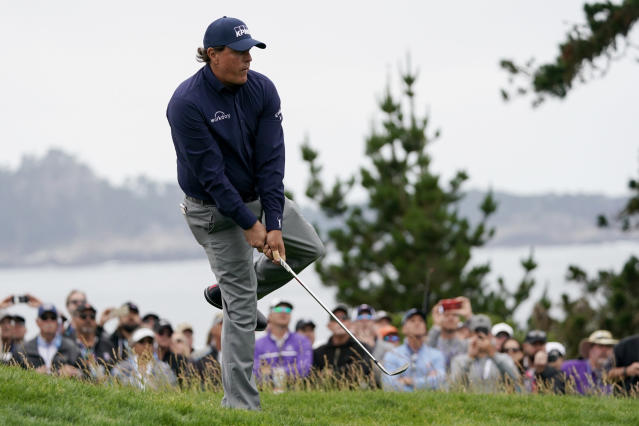 Phil Mickelson reacts to a shot on the 12th hole during the second round of the U.S. Open golf tournament Friday, June 14, 2019, in Pebble Beach, Calif. (AP Photo/Carolyn Kaster)