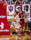 Indiana forward Race Thompson (25) tries to recover a loose ball during the second half of an NCAA college basketball game against Rutgers, Sunday, Jan. 24, 2021, in Bloomington, Ind. (AP Photo/Doug McSchooler)