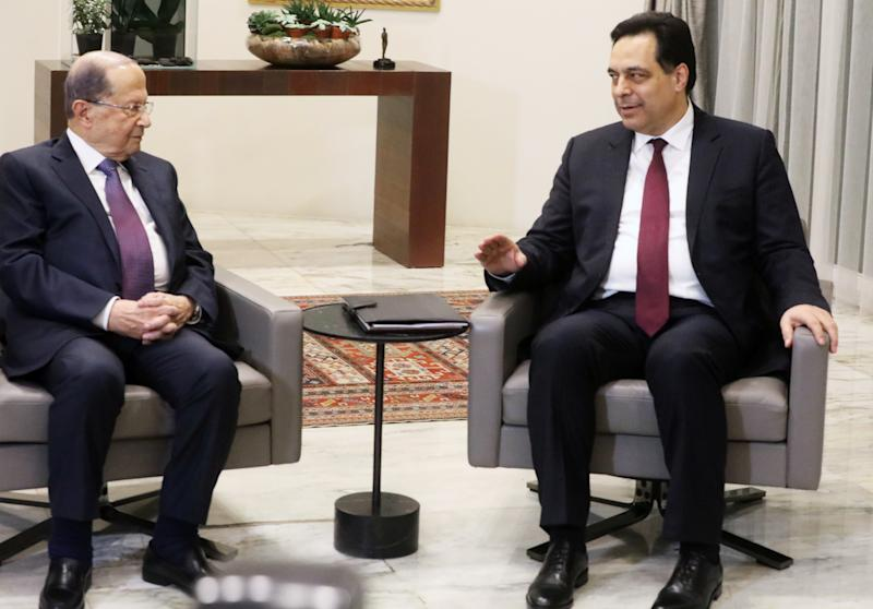 Designated Prime Minister Hassan Diab meets with Lebanon's President Michel Aoun at the presidential palace in Baabda