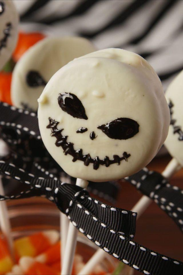 """<p>Create ghoulish characters using black icing.</p><p><em><a href=""""https://www.delish.com/cooking/recipe-ideas/recipes/a55618/jack-skellington-oreo-pops-recipe/"""" rel=""""nofollow noopener"""" target=""""_blank"""" data-ylk=""""slk:Get the recipe from Delish »"""" class=""""link rapid-noclick-resp"""">Get the recipe from Delish »</a></em></p>"""