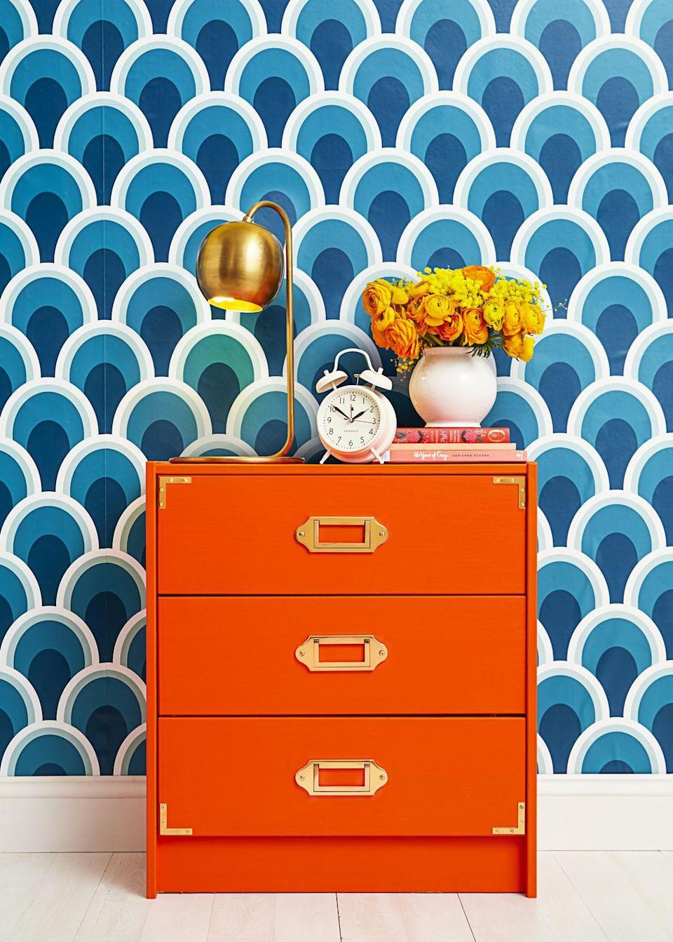 "<p>Paint one piece of furniture an unexpected color. This vibrant orange dresser looks way more expensive than its IKEA origins thanks to new paint and hardware. </p><p><a href=""https://www.goodhousekeeping.com/home/decorating-ideas/a47625/diy-rope-star-mirror/"" rel=""nofollow noopener"" target=""_blank"" data-ylk=""slk:RELATED: This Simple Mirror DIY Will Upgrade Any Boring Wall in Your Home"" class=""link rapid-noclick-resp""><strong>RELATED:</strong> This Simple Mirror DIY Will Upgrade Any Boring Wall in Your Home</a></p>"