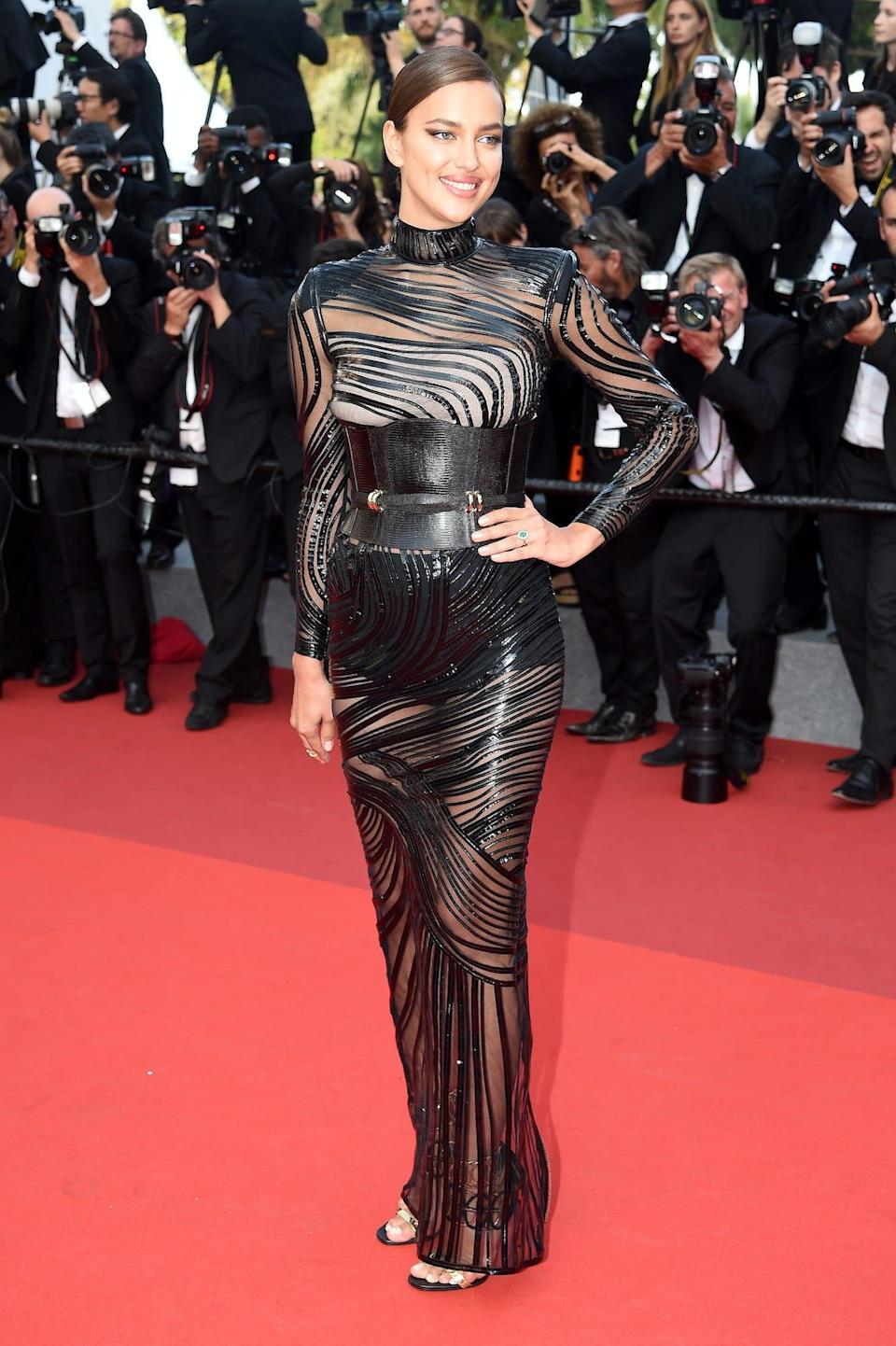 Irina Shayk wears a black dress and corset at the 2017 Cannes Film Festival.