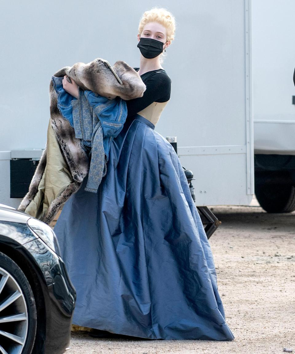 <p>Elle Fanning is dressed in full costume while filming for her Hulu series<em> The Great</em> on Tuesday in Richmond Park, London.</p>