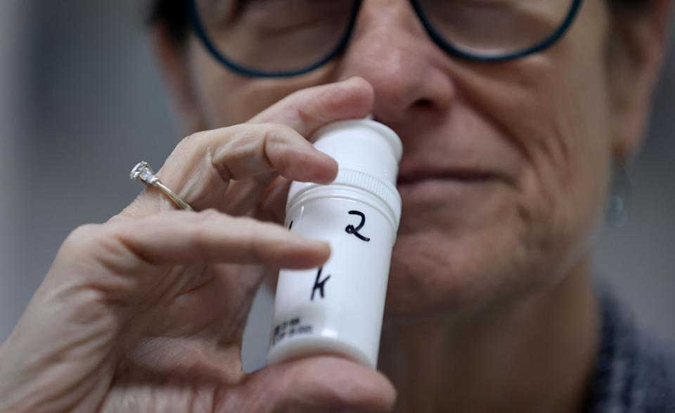 A technician displays a sample of an anti-viral nose spray developed by biotech company SaNOtize at the company's lab in Nezz Ziona on April 7, 2021. (Photo by Emmanuel DUNAND / AFP) (Photo by EMMANUEL DUNAND/AFP via Getty Images)