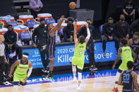 Sacramento Kings guard Buddy Hield (24) hits a 3-point basket against Minnesota Timberwolves guard Ricky Rubio (9) during the first quarter of an NBA basketball game in Sacramento, Calif., Wednesday, April 21, 2021. (AP Photo/Hector Amezcua)