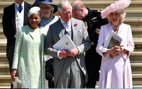 Prince Charles escorts Doria Ragland from St George's Chapel after her daughter Meghan's wedding to Prince Harry - Credit: Getty Images Europe/WPA Pool