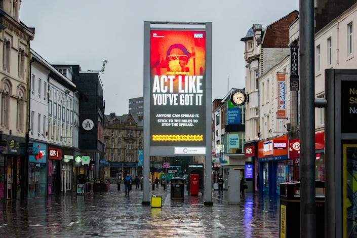 NEWCASTLE UPON TYNE, UNITED KINGDOM - 2021/01/20: General view of the Covid-19 'Stay Home Save Lives' publicity campaign poster Northumberland street in Newcastle upon Tyne in the north of england during the third national lockdown. (Photo by Nicolas Briquet/SOPA Images/LightRocket via Getty Images)