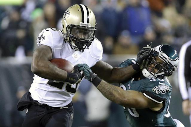 New Orleans Saints' Khiry Robinson, left, tries to break free of Philadelphia Eagles' Mychal Kendricks during the first half of an NFL wild-card playoff football game, Saturday, Jan. 4, 2014, in Philadelphia. (AP Photo/Matt Rourke)
