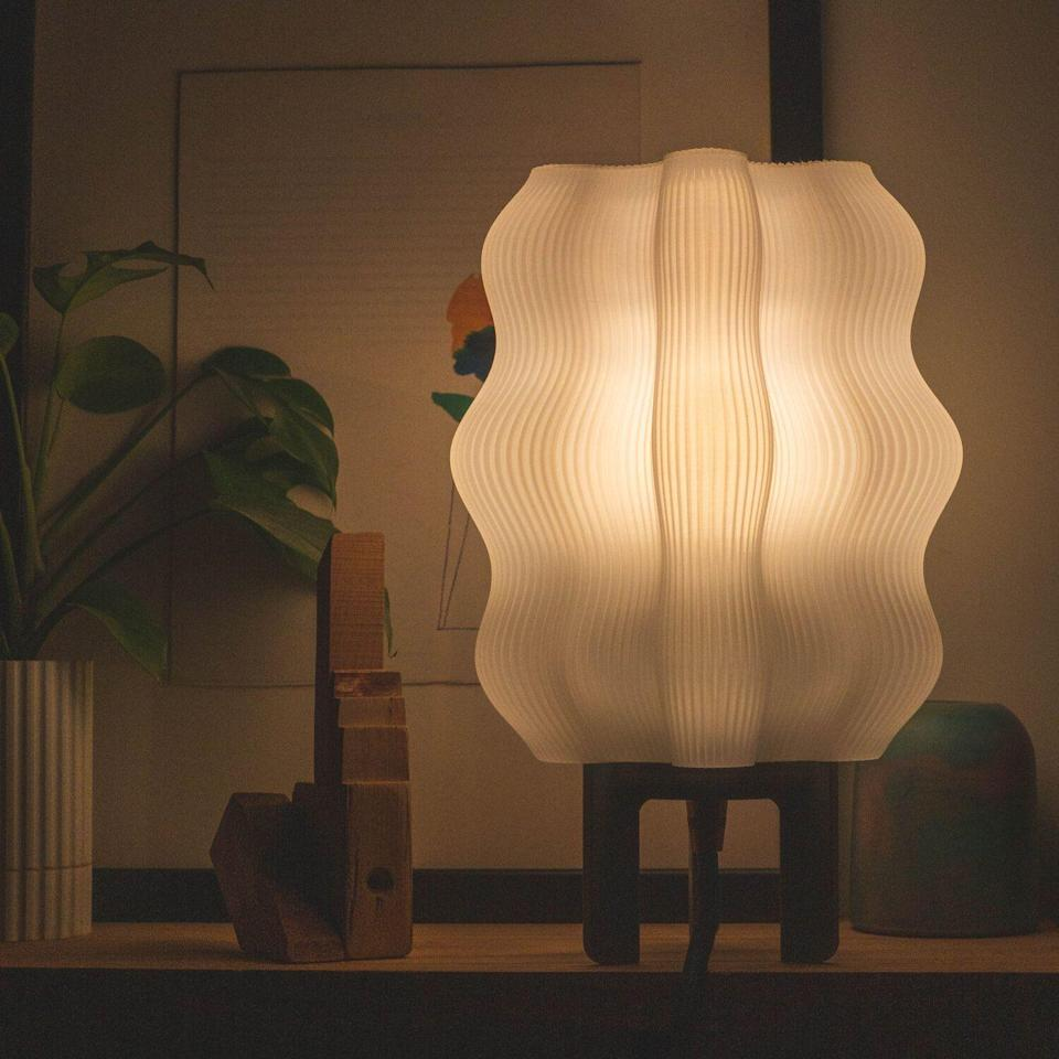 """<p><strong>Wooj</strong></p><p>wooj.design</p><p><strong>$105.00</strong></p><p><a href=""""https://www.wooj.design/shop/lamp"""" rel=""""nofollow noopener"""" target=""""_blank"""" data-ylk=""""slk:Shop Now"""" class=""""link rapid-noclick-resp"""">Shop Now</a></p><p>You don't want to rely on harsh lighting as the days get shorter. Try the Wavy Lamp, which emits the softest glow.</p>"""