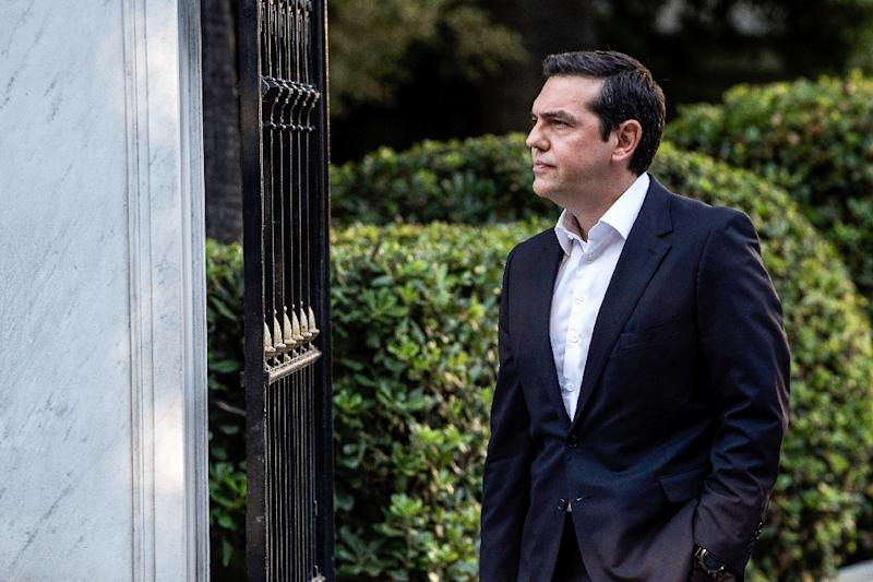 Greek Prime Minister Alexis Tsipras announced an accord that he hopes will end a long name row with Macedonia (AFP Photo/ANGELOS TZORTZINIS)