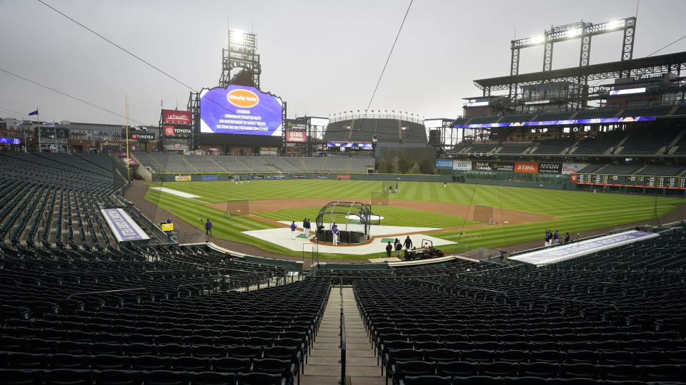 Players take part in batting practice as a light rain descends on Coors Field Tuesday, April 6, 2021, before the Colorado Rockies host the Arizona Diamondbacks in a baseball game in Denver. Major League Baseball announced that Coors Field will be the venue for the 2021 All-Star Game after the Midsummer Classic was moved out of Atlanta because of sweeping changes to voting rights established in the state of Georgia. (AP Photo/David Zalubowski)