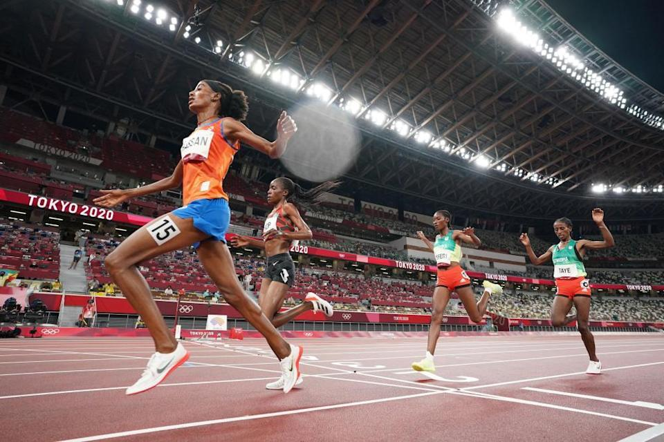 Sifan Hassan of the Netherlands, Agnes Jebet Tirop of Kenya, Senbere Teferi of Ethiopia and Ejgayehu Taye of Ethiopia in action in the athletics in the Olympic Stadium.