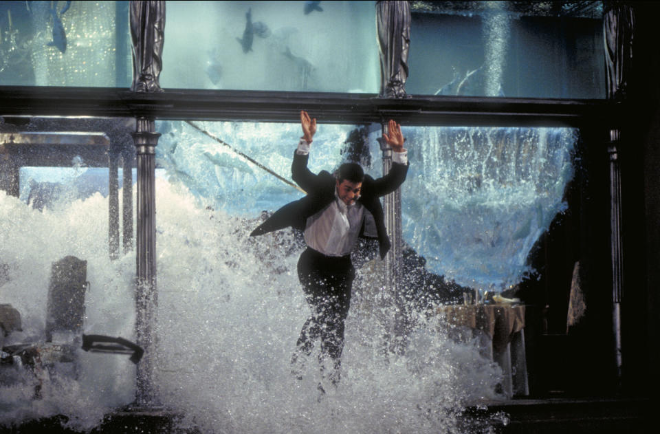 American actor Tom Cruise as Ethan Hunt, escaping through the collapsing aquarium in a restaurant, in a scene from the film 'Mission: Impossible', 1996. (Photo by Murray Close/Getty Images)